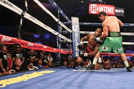 Love goes down after a left hook from Medina