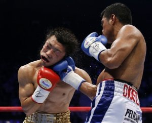 Gonzalez (right) lands an uppercut on Yaegashi (left)