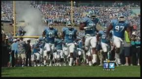 The UNC football team runs onto the field (Courtesy of Channel 11 Eye Witness News)