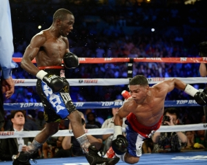Crawford (left) knocks down Gamboa (right)