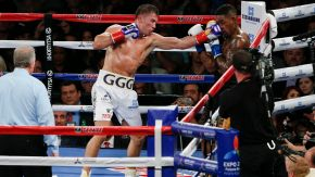 Golovkin (left) throwing a left hand at Monroe (right) Esther Lin/Bad Left Hook/SB Nation