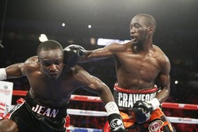 Crawford (right) lands a solid right hook on Jean (left) to score a knockdown in round 1