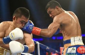 Gonzalez (right) lands a hard left hand on Viloria (left)
