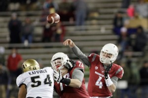 Luke Falk was in the middle of another stellar performance before he was knocked out of the game. (Young Kwak, AP)