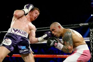 Canelo (left) lands a left uppercut on Cotto (right)