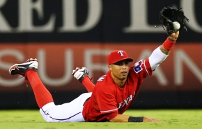 MAILMASTER ARLINGTON, TX - SEPTEMBER 30:  Leonys Martin #2 of the Texas Rangers holds up the ball after making an out on Delmon Young #15 of the Tampa Bay Rays in the seventh inning during the American League Wild Card tiebreaker game at Rangers Ballpark in Arlington on September 30, 2013 in Arlington, Texas.  (Photo by Ronald Martinez/Getty Images)__Subject: gettymartin On 2013-12-21, at 3:21 PM, Grant, Rob wrote: ARLINGTON, TX - SEPTEMBER 30: Leonys Martin #2 of the Texas Rangers holds up the ball after making an out on Delmon Young #15 of the Tampa Bay Rays in the seventh inning during the American League Wild Card tiebreaker game at Rangers Ballpark in Arlington on September 30, 2013  Leonys Martin.jpg