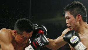 Miura (left) takes a solid right from Vargas (right)
