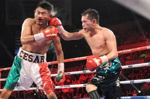 Donaire (right) lands a hard right hand on Juarez (left)