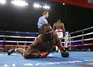 Jennings (left) moments after being knocked down by a left uppertcut from Ortiz (right)