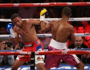 Verdejo (left) throws a left hook against Dos Santos (right)