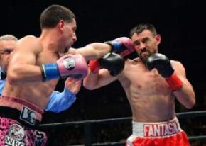 Danny Garcia (pink shorts) battles Robert Guerrero (red shorts) during their WBC welterweight boxing title fight at Staples Center. Garcia won by decision. Mandatory Credit: Jayne Kamin-Oncea-USA TODAY Sports