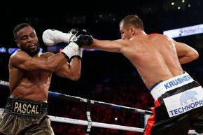 Kovalev (right) lands a jab on Pascal (left) in their rematch