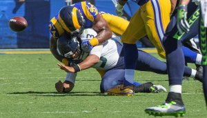 Russell Wilson's fumble led to a Rams field goal. (Mike Siegel / The Seattle Times)